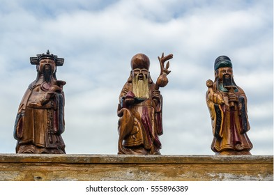 """Chinese lucky gods, Shou or Siu statues """"Longevity"""" on sky  background, Select Focus.(Public)"""