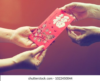 Chinese Lunar New Year concept red envelope with Chinese character means happiness or good fortune, and Chinese sentence means wishing you prosperity and may all your wishes come true!