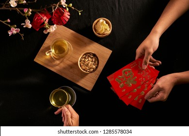 """Chinese Lunar New Year concept red envelope with Chinese character means happiness or good fortune, the chinese sentence means """"Wishing you prosperity"""" and """"May all your wishes come true""""."""