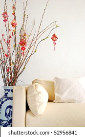 Chinese Lunar New Year decoration with modern sofa. For New Year objects, celebration and festival, and culture and lifestyle concepts.