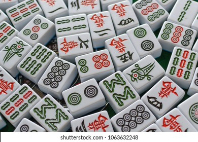 chinese mahjong on the table,the chinese word meaning ten thousand