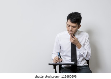 Chinese male student or business man taking an exam test