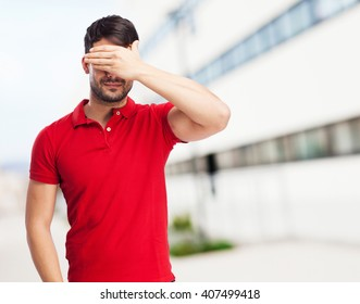 chinese man covering his eyes
