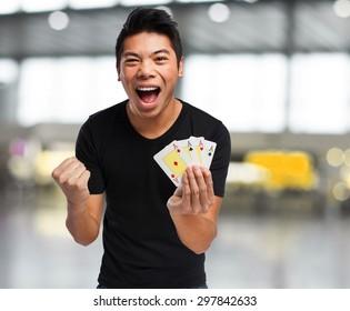 chinese man playing poker