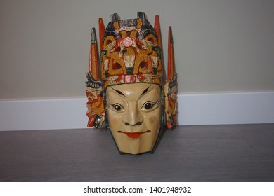 Chinese mask handmade in wood and painted