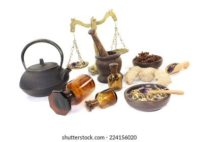 Chinese medicine with herbs and scale on light background