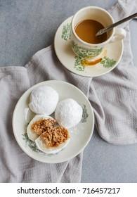 Chinese mochi with ground peanut and sugar filling with smooth and rich local milk coffee / Craving Chinese Sweet Delicacies / Chinese popular aftermeal dessert whether after breakfast or dinner
