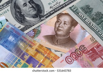 Chinese money and american dollar close up view as background