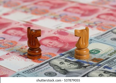 Chinese Money Note vs US Money Note. Photo shows the black and white knights facing each other.