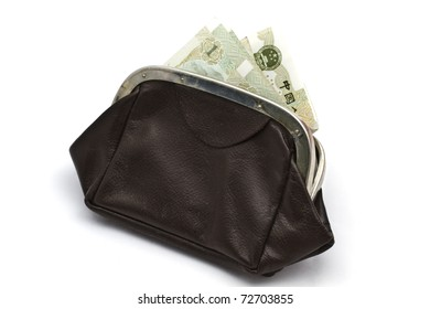 Chinese money in old purse isolated on white background