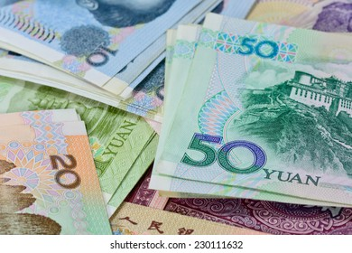 Chinese money (renminbi) - variety Yuan bank notes for money and business concept ; selective focus with blur background