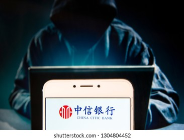 Chinese multinational banking and financial services corporation China Citic Bank logo is seen on an Android mobile device with a figure of hacker in the background.