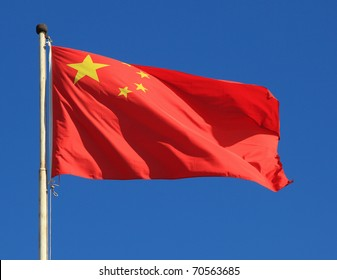 Chinese national flag with blue sky as background