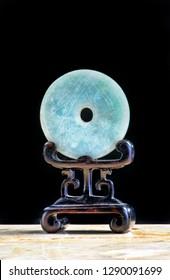 Chinese nephrite jade bi disk made in the 19th century.