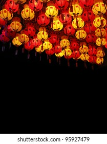 Chinese New Year celebrative red and yellow lantern illuminating the night sky.