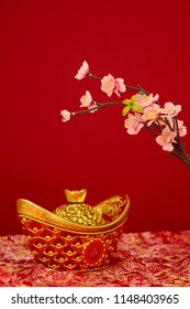 Chinese New Year decoration 2019 on a red background  Flowers of good fortune and lump of gold. Chinese characters Wealthy wealth
