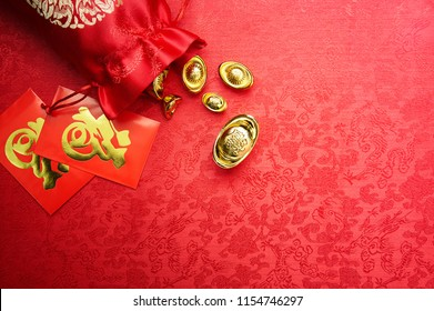 Chinese New Year decoration - Gold sycee (Foreign text means wealth) and red packet (Foreign text means Prosperity)