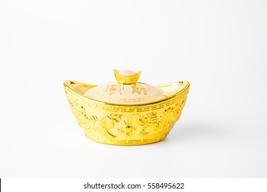 Chinese new year decoration with golden ingots on white background.