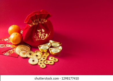 Chinese new year decorations, money bag, Orange, Gold Coins with character meaning, good luck, riches, healthy, honour, happiness on red background