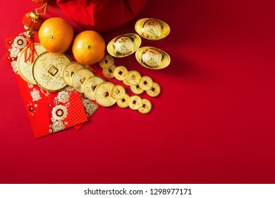 Chinese new year decorations, money bag, Orange, Gold Coins with character meaning, good luck, riches, healthy, honour, happiness on red background.