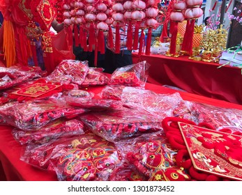 Chinese new year decorations on street market stall.