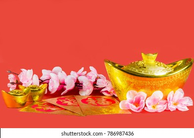Chinese New Year decorations on red background (English translation for foreign text means blessing, luck and rich).
