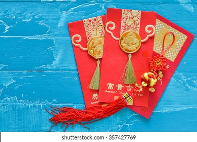 Chinese New Year Decorations  red envelope and Traditional chinese knots ornament  meaning safe trip wherever you go. (Foreign text means spring season greeting)