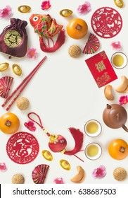 "Chinese new year decorative item with ""prosperity""  wording and food on white background. Flat lay text space image."
