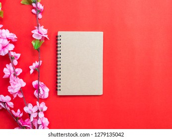 Chinese new year festival decorations, notebook,plum blossom,on red background.