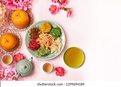 Chinese New Year festival food and drink decorated with peony flower and plum blossom . Yee Sang or Yu sheng a special dish serve during Chinese New Year.