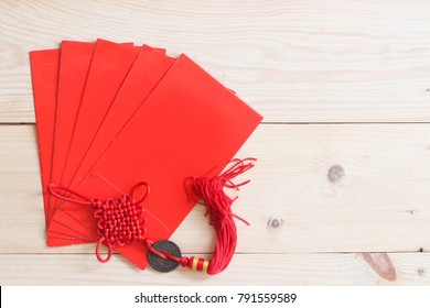 Chinese new year festival red envelope on wood background.