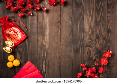"""The Chinese new year festival, Top view flat lay happy Chinese new year or lunar new year decorations celebration with copy space on wood background (Chinese character """"FU"""" meaning fortune good luck)"""
