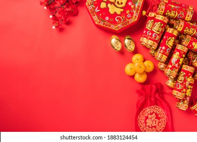 Chinese new year festival, Top view flat lay happy chinese new year or lunar new year decorations celebration with copy space on red background (Chinese character