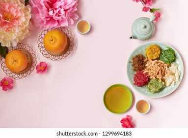 Chinese New Year food and drink decorated with peony flower and plum blossom . Yee Sang or Yu sheng a special dish serve during Chinese New Year.