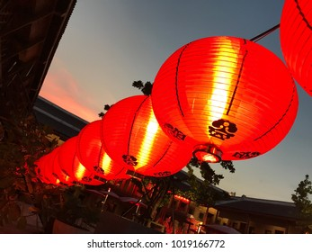 Chinese new year lanterns hang up front of courtyard area with evening sky, at Lhong 1919 riverfront in Bangkok, Thailand, historical site of Chinese old shrine dating back to King Rama IV (1851-1868)