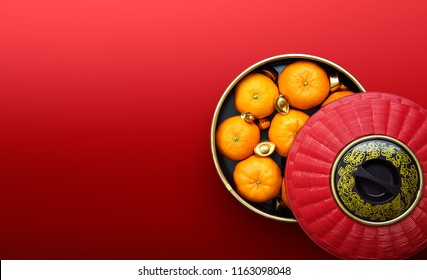 Chinese New Year - Mandarin oranges and Chinese gold sycee in traditional container