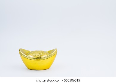 "Chinese new year ornament.Decoration of chinese gold ingots in isolated white background with copy space.Chinese text language means blessing ""Wealthy and good luck"""