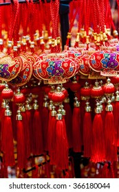 Chinese New Year ornaments on sale. These common ornaments have the Chinese word meaning Blessings printed on them. They are typically hung at home to signify good luck.