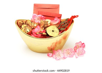 Chinese new year ornaments, red packets, gold ingots and coins on white background