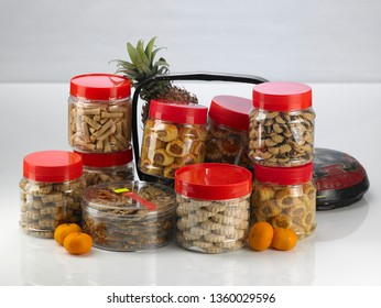 Chinese new year pineapple tarts in jar with pineapple and basket