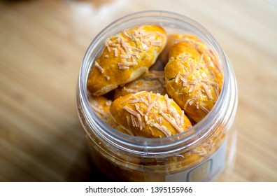 Chinese New Year Snacks and Goodies - Cheese Pineapple Tart. This is a modern variation of the popular pineapple tart. These snacks are offered at house visits during Chinese New Year
