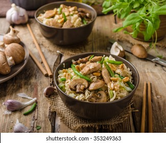 Chinese noodles with brown mushrooms, simple and delicious fast food.