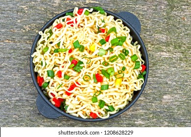Chinese noodles in a cast iron bowl. Hot Chinese noodles.