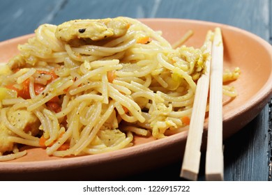 Chinese noodles over blue wooden board. Horizontal closeup shot