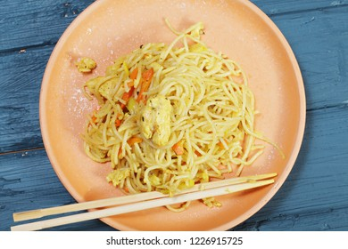 Chinese noodles in plate. Overhead horizontal shot