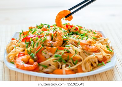 Chinese noodles with shrimp in soy sauce and vegetables