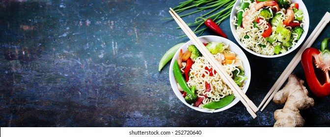 Chinese noodles with vegetables and shrimps. Food background