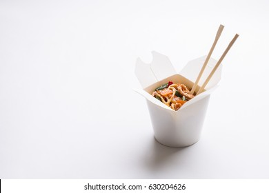 Chinese noodles in white box on isolated background
