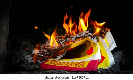 Chinese Offering Paper or joss paper was burning in the stove in Chinese Ghost Festival. It was believe that to send the money or asset to the predecessor who passed away.