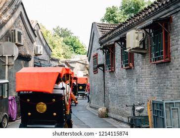 Chinese old street Hutong and traditional rickshaw at Shichahai in Beijing, China